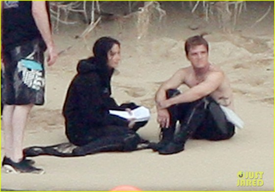 **EXCLUSIVE** WET SUIT! Jennifer Lawrence checks out co-star Josh Hutcherson as he goes topless while the pair film on the beach for the second part of 'The Hunger Games' franchise 'Catching Fire' on location in Hawaii