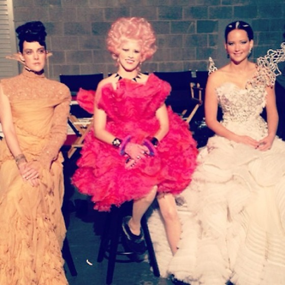 Jena Malone (Johanna Mason), Elizabeth Banks (Effie Trinket) and Jennifer Lawrence (Katniss Everdeen) in their costumes for Capitol Portrait photoshoot