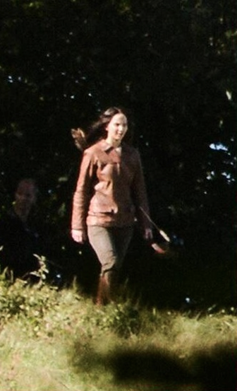 Jennifer Lawrence as Katniss Everdeen, wearing Katniss' signature jacket on MOCKINGJAY set